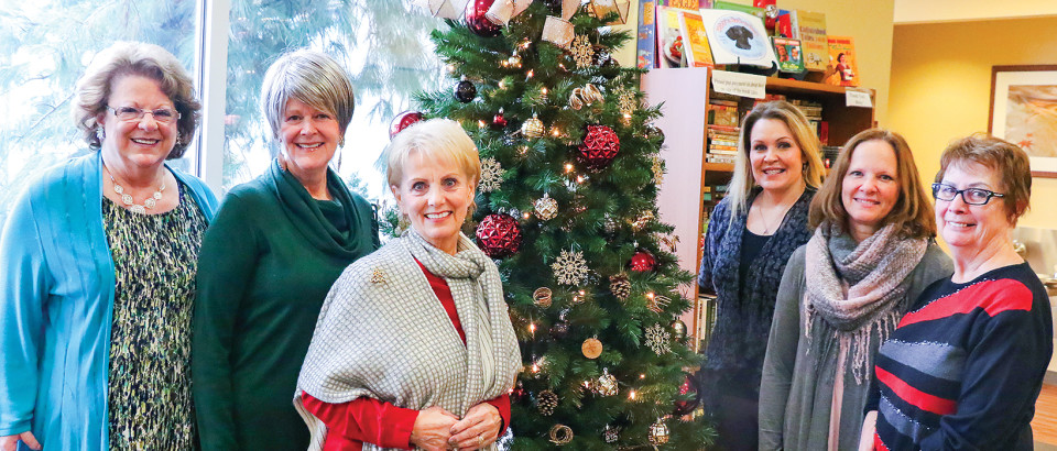 Ginny Oakes, Patti Wheeler, Dee Coulter, Kristi Masterson, Sue Shoemaker and Carol Humphrey gather around the Christmas tree BetterCARE will raffle off.