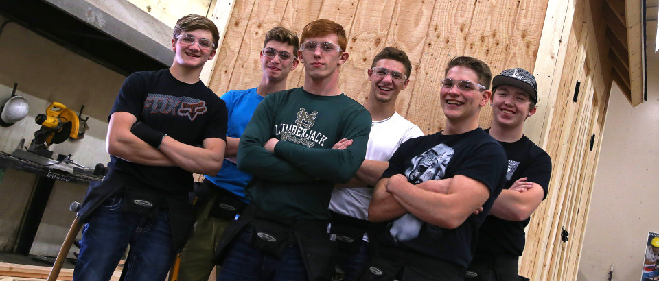 (From left) Garret Flach, Patrick Asbury, Kaleb Brown, Bryant Asbury, Forrest Oughton and Blake Balbi are six students in the Construction Technologies program at St. Maries High School. Behind them is one of their projects.