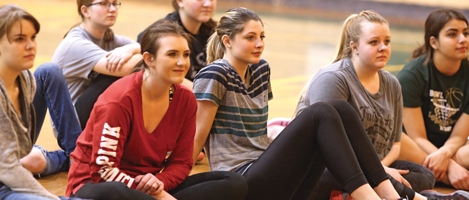 (Back) Hailey Johnson, Claire Edwards, Margaret Ebert, (front) Hunter Morris, Cassie Blankenship, Tayva Hendrickx and Elena Moore watch as other contestants for the Distinguished Young Women program practice their talent during rehearsal April 3. The program is Saturday, April 8. Doors open at 6 p.m. with the opening number at 7 p.m.