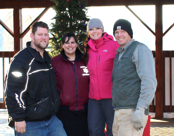 Colton And Kimmy Galle and Teri and Rusty Riberich in front of the tree in the gazebo at city park. These four headed up decorating and organizing for the annual Harrison Winterfest celebration Saturday.