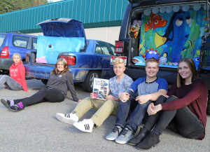 "(From right) Kaley Auer, Carson Humphrey, Toby Young, Kaylee Nelson and Samantha McNulty show off their decorated cars, which will appear at ASB's ""Trunk or Treat"" event Oct. 31. Children in St. Maries will be able to meet with their favorite Lumberjacks as they gather candy and look at the group's decorated cars."