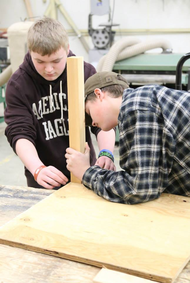Kristian Hindman and Michael Lounsbury construct a table as part of a dog obstacle course during carpentry class Jan. 17. St. Maries High School students and teachers, along with volunteers at the Benewah County Humane Society, are working together to build the obstacle course.