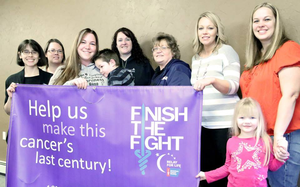 Aki Hicks, Brandi Scheffelmaier, Crystal Houck holding Dalton Swisher, Stephanie Remington, Sandy Auer, Kristina Mills, Starla Thompson and her daughter Aspen invite the community to the Relay for Life kick-off in St. Maries, which is March 11.