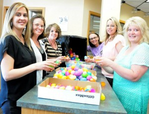 AmericanWest Bank employees help stuff eggs for the St. Maries Easter Egg Hunt each year. They include Tracy Fraser, Karen Gibson, Treasure Ueland, organizer Tami Holdahl, Katrina Mills and Shauna Charles.