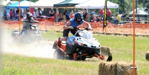 Austin Schiermeister, racer #101, gains the lead heading down the track at the annual grass drags July 2013. The event held races Saturday and Sunday in a hay field adjacent to Lumberjack Lane just outside St. Maries.