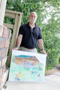 Chris Renaldo, a member of the St. Maries Rotary Club, holds a drawing of the proposed St. Maries Community Amphitheatre that the club is helping to fundraise for the construction of. The club is hoping to get other community groups involved in the project this year.