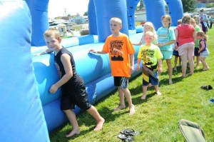 Children line up to take a turn on the water slide at last year's Family Fun Festival. The water attraction was easily one of the most popular attractions at the festival.