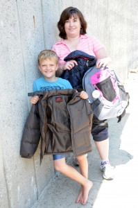 Dillon Harold and Faithann Ebert show off a few items to be available the School Clothes Giveaway, organized by the Church of the Nazarene in St. Maries Saturday.