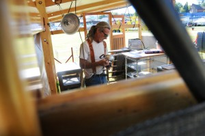 Dennis Wheeler works on setting up his oriental food booth at city park Tuesday before the start of the Paul Bunyan Days celebration.