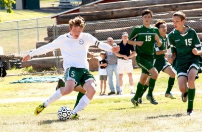 Thomas Cook looks to take the ball down the field and keep it safe from the opposing team during a game in St. Maries.