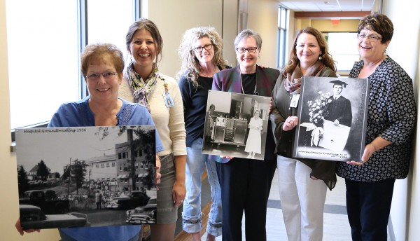 Judy Bailey, Polly Grasham, Robin Renaldo, Colleen Smith, Debbie Flach and Marie Ross display a few of the pictures to hung in the hallway at Benewah Communtiy Hospital. The women, along withJeannie Johnson, completed a historic exhibit of pictures and stories, which will be unveiled at 9 a.m. Saturday.