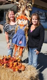 Sue Shoemaker and Shirley Ackerman helped decorate downtown Main Avenue in festive fall decorations. They hope to inspire businesses and other offices to do the same.