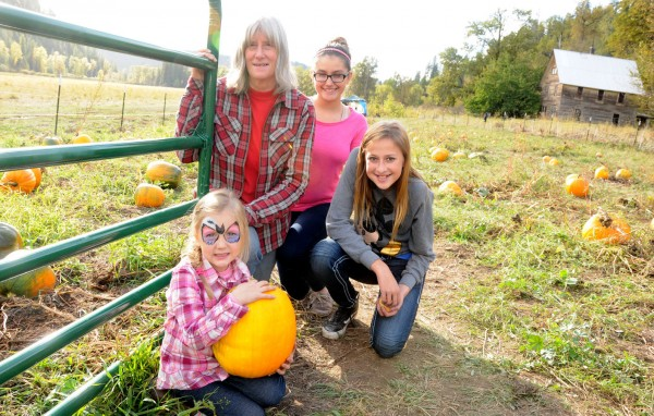 Lynne Birdsall and her granddaughters Ella Seyferth, Darcy Millikin and Jenna Bauer assist with various activities at Papa Patterson's Pumpkin Patch. The new venture is the only pumpkin patch open to the public in the area this year.