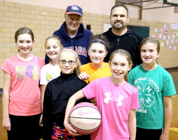 Local children are invited to participate in the Elks Hoop Shoot Nov. 23 so they should start practicing now. Pictured here are organizers Jim McCuaig and Bryan Chase and some local basketball players including Trista Janssen, Chandra Renner, Sami Badgett, Gracie Barden, Ashlyn Buell and Hope Aasgard.