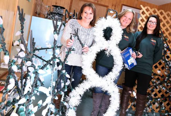 "Shirley Ackerman, Sue Shoemaker and Betsy Porter stand with the new lights and decorations the St. Maries Chamber of Commerce will be using to ""light up"" St. Maries for the Christmas season."
