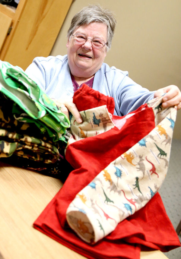 Pat Davenport, of Grammies Jammies, says the group has sewn more than 300 pairs of pajamas once again for area children. The pajamas will be distributed with the Elks Christmas Baskets.