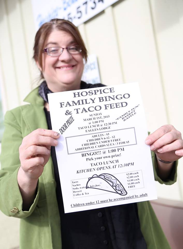 Robin Hodgson, director of Hospice of Benewah County, displays the flier for the Hospice's Family Taco Bingo fundraiser, which is Sunday, March 1.