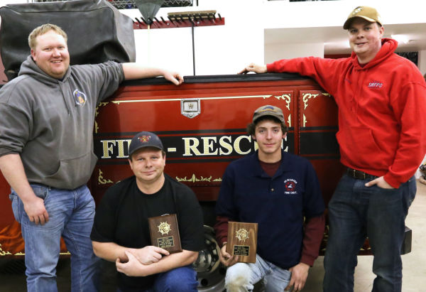 Wesley Rice (left) and Josh Masterson (right) were named firefighters of the year for the St. Maries fire district. Brian Bigelow and Hadley McInturff were noted for being the most improved.