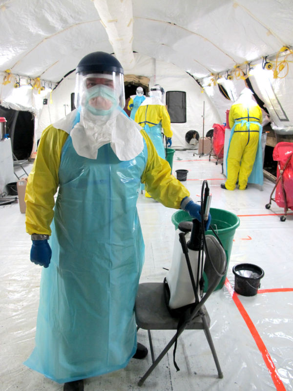 Dale Bates suited up for work in the ward at an Ebola treatment facility in Liberia.
