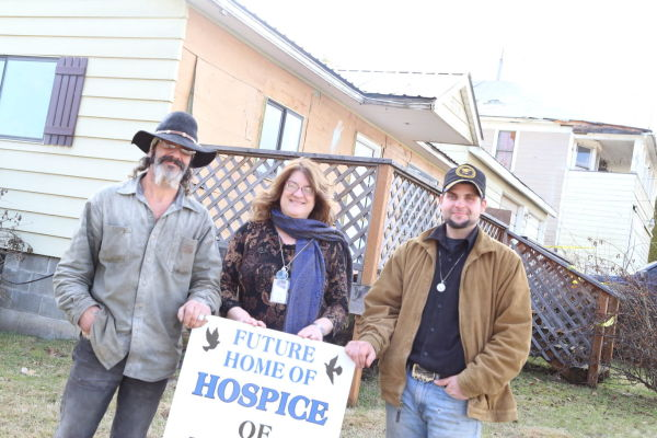 Director Robin Hodgson stands with volunteers who are helping renovate this house and property to be used as the new location for Hospice of Benewah County.