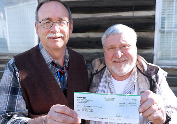 Steven Henson, manager of Potlatch-St. Maries Complex, presented St. Maries Mayor Harry Grubham with a check for $10,000. The money will be put toward the amphitheatre project in city park.