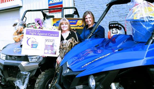 Destrie Brown and Pam Shawver are pictured with a mixture of raffle and silent auction items that will be up for grabs during the Ride Because We Care Fun Run, which is May 9.