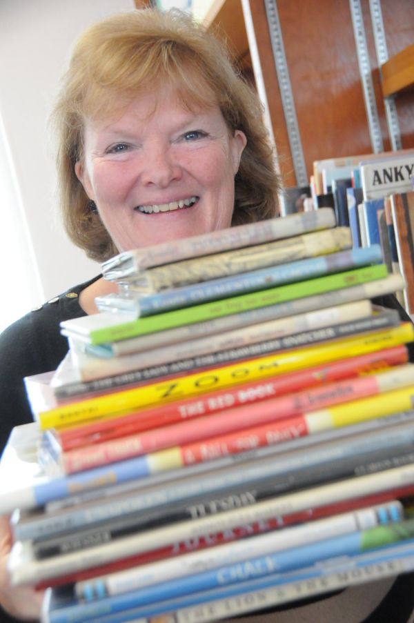 Leslee Adams stands behind a stack of picture books for the Wordless Book contest. The St. Maries Library has organized the literary endeavor in honor of Children's Book Week.