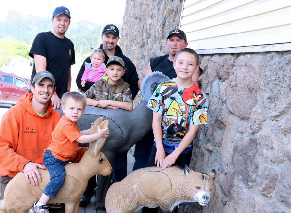 Members of the local archery club are planning a shoot this summer with 40 3-D targets some of which are shown here. Pictured include (front, from left) Bret and Peter Nelson, James Plante, (back, from left) Scott Schiermeister, Kurtis Plante holding Brooke, Freddie Plante and Jason Brebner.