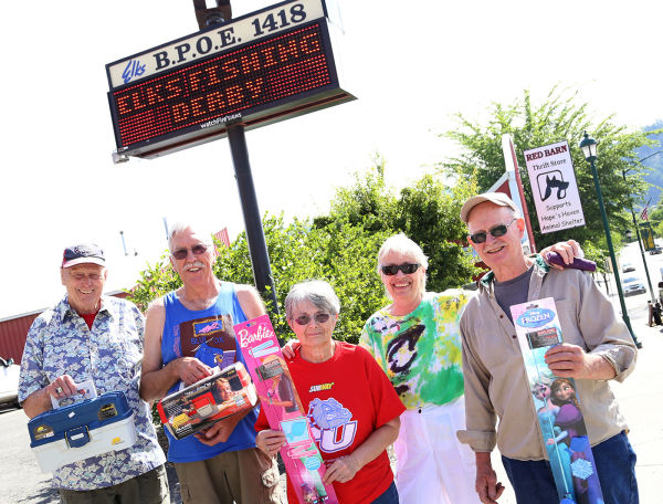 The Elks 7th Annual Fishing Derby is Saturday. Everyone is invited to participate. Those who do participate must register by Friday. Jim McCuaig, Phil Epler, Eleanor Law, Beverly McCuaig and Albert Law display some of the prizes up for grabs including fishing poles and tackle boxes.