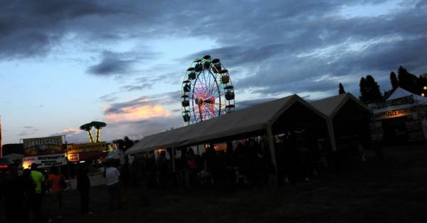 The sun sets over the carnival at the 2014 Paul Bunyan Days celebration at City Park in downtown St. Maries. Rides like the Ferris Wheel are a mainstay, year after year.