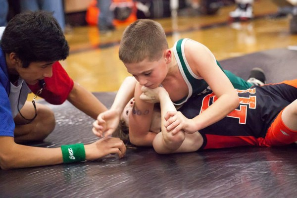 Kody Watkins pins his opponent at a 2014 North Idaho Wrestling League tournament. Photo courtesy of Harvey Photography.