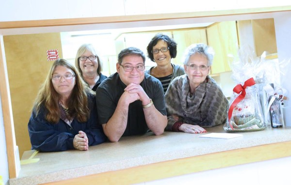 Members of the St. Mary's Immaculate Catholic Church in St. Maries, including Barbara Ross, Nancy Turner, Father Jerome Montez, Judy Zook and Marsha Habberstad are preparing the annual Christmas bazaar.