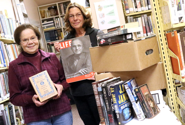 Hundreds of books will be for sale during the Friends of the Library's Annual Book Sale at the St. Maries Public Library Nov. 7. A few special items will also be sold including a McGuffey's Reader's Set held by Linda Foxworth and historic Lifetime magazines held by Laura Allen.