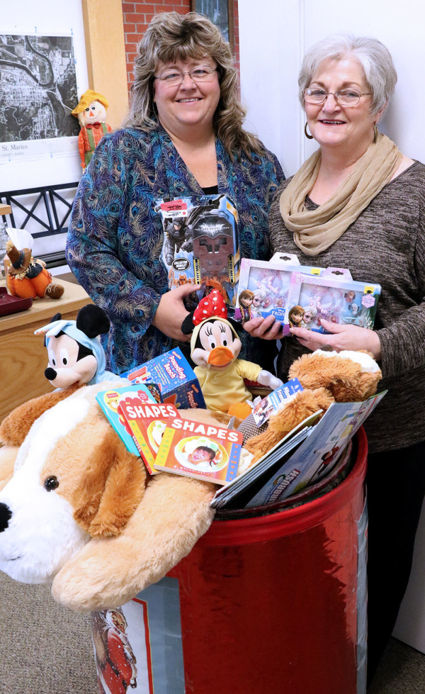 Celia Sibert and Renee Duke help with the Toys for Tots program in Benewah County. Donation bins to collect new toys will be in several business following Thanksgiving.