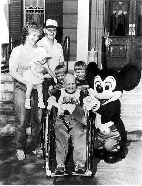 Thirty-three years ago Wishing Star sent the entire Turner family to Disneyland. Floyd and Nancy Turner's son Patrick, center, had terminal cancer and the week's stay gave the family a chance to create new memories together. Mrs. Turner is holding Marissa and Travis and Tim are pictured alongside their brother.