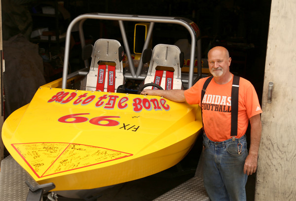 Charlie Reynolds shows off the jet boat he will be racing in the World Championship Jet Boat Races starting May 20. Displayed on the bow are the names of Mr. Reynolds' supporters, who got a chance to sign the boat during an event at the Grapple Haus May 5.