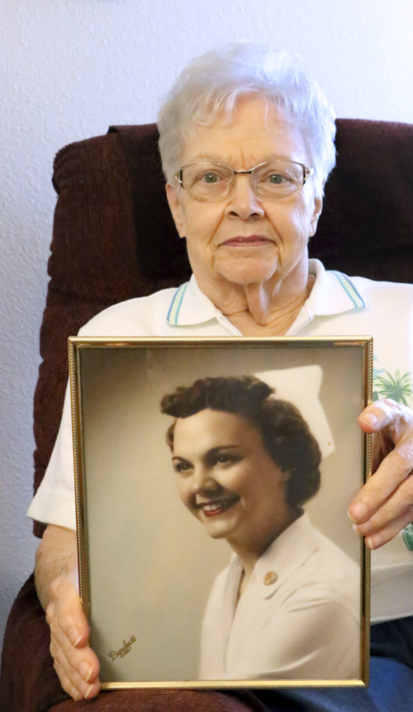 Francie Walters hold a portrait of herself that was taken during the time she worked as a nurse. Mrs. Walters is beiong honored for the contributions she made at a ceremony Friday, Aug. 26. Tamarack Conference Room at Benewah Community Hospital will be renamed in her honor.