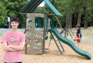 Dawson Marunde, left, stands in front of the new playset he installed at Vic Camm Park as part of his project to earn his Eagle rank for Boy Scouts.