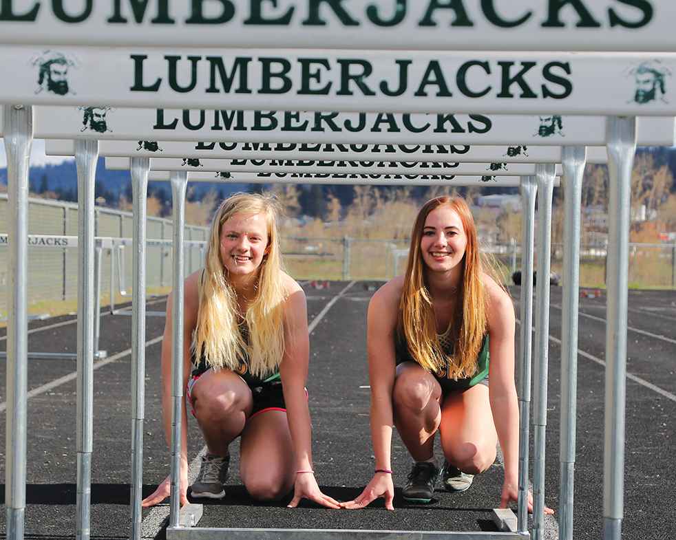 Sisters Bethan (left) and Morgan (right) Suchoski run track for St. Maries. Both look to earn state berths in their respective events at next weekend's district tournament.