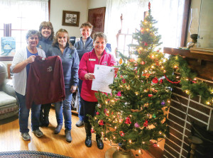 Annie Fredericks, Serena Crane, Shirley Ackerman, Yvette Benham and Linda Weinmann are gearing up for the annual Christmas in St. Maries event Saturday.
